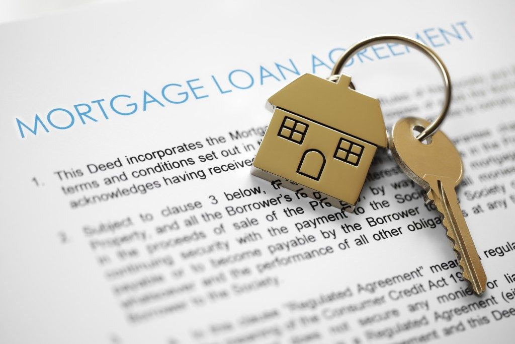 Mortgage loan agreement application with house-shaped key
