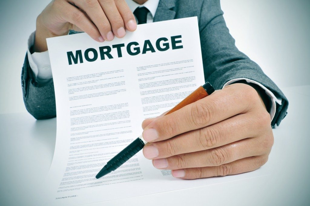Man holding out a mortgage contract