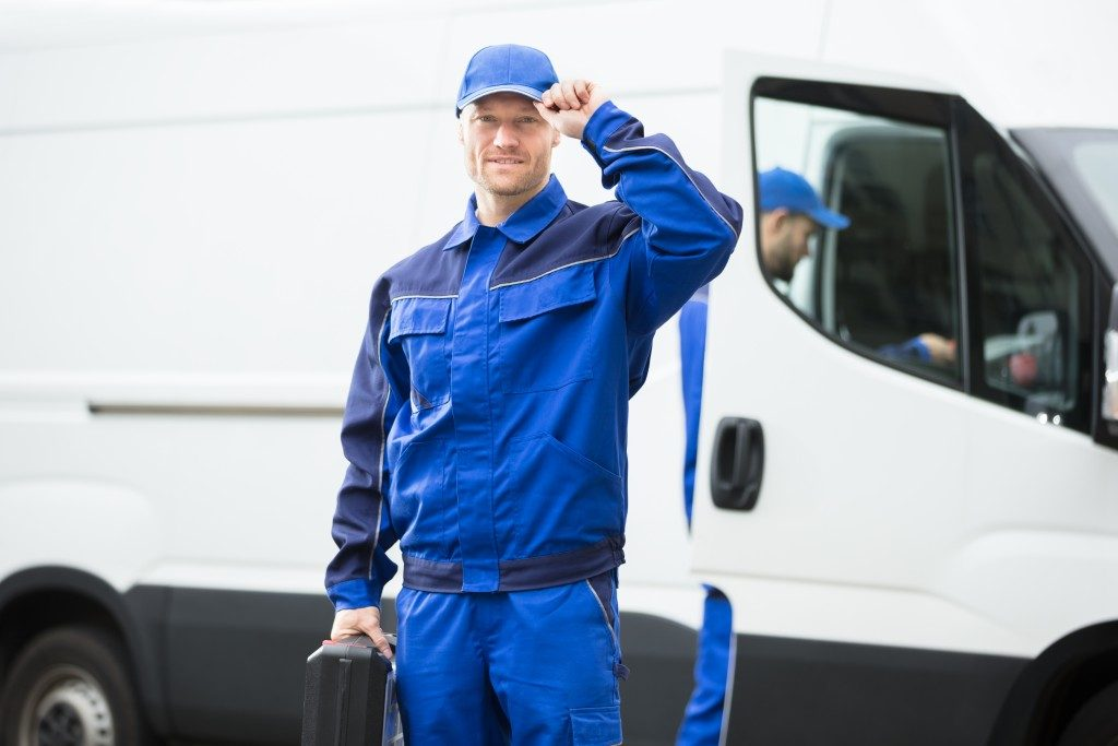 man infront of his delivery van