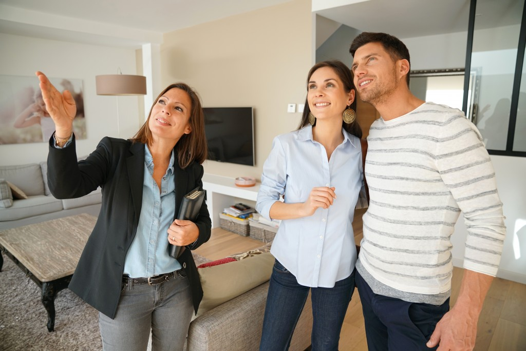 couple looking at the model home with realtor