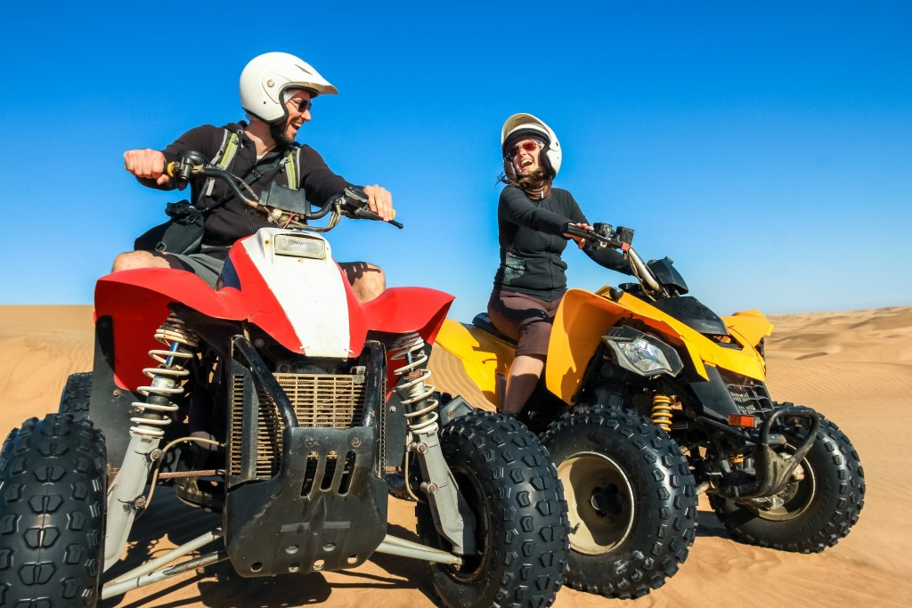 Couple riding ATVs