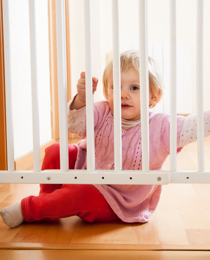 baby near safety gate of stairs