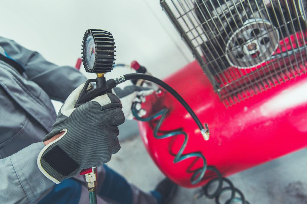 man using air compressor