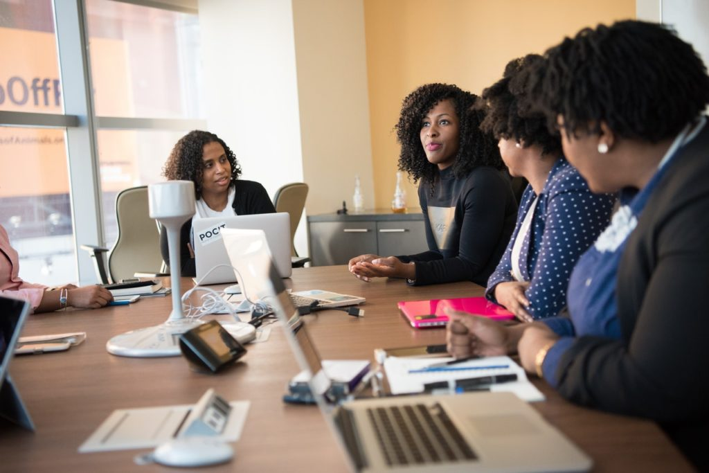 women discussing business plans