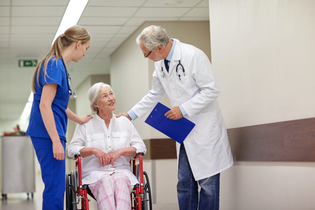 woman being assisted by doctor and nurse
