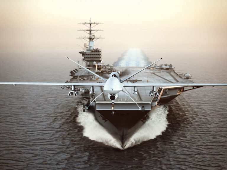 drone flying from aircraft carrier