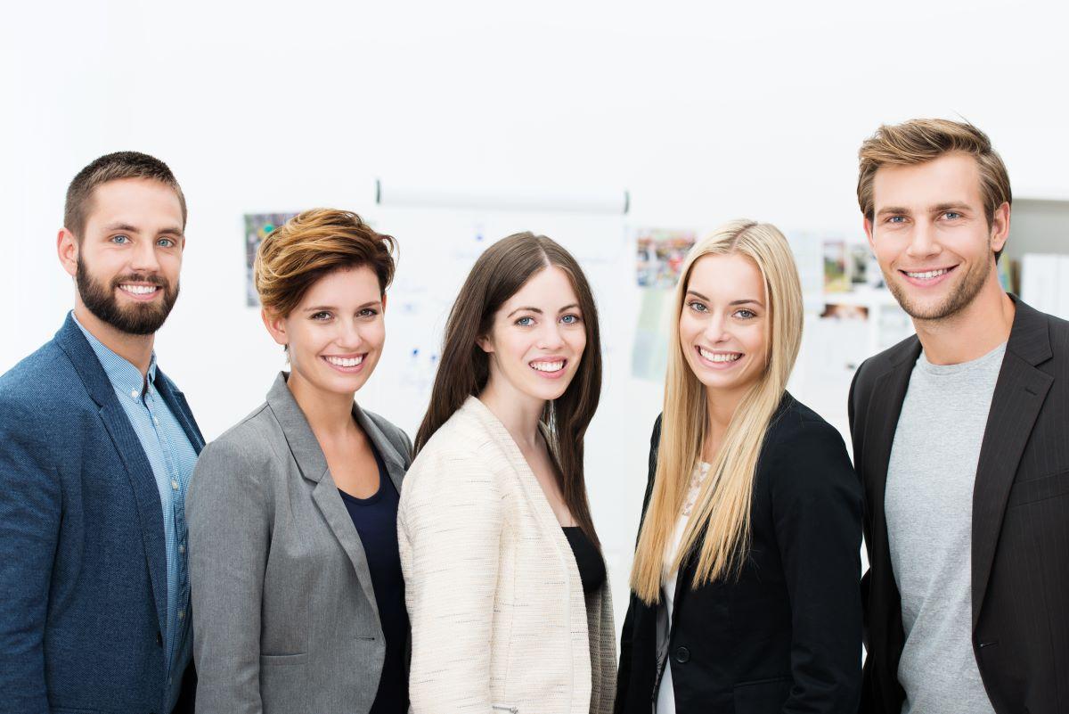 employees posing smiling