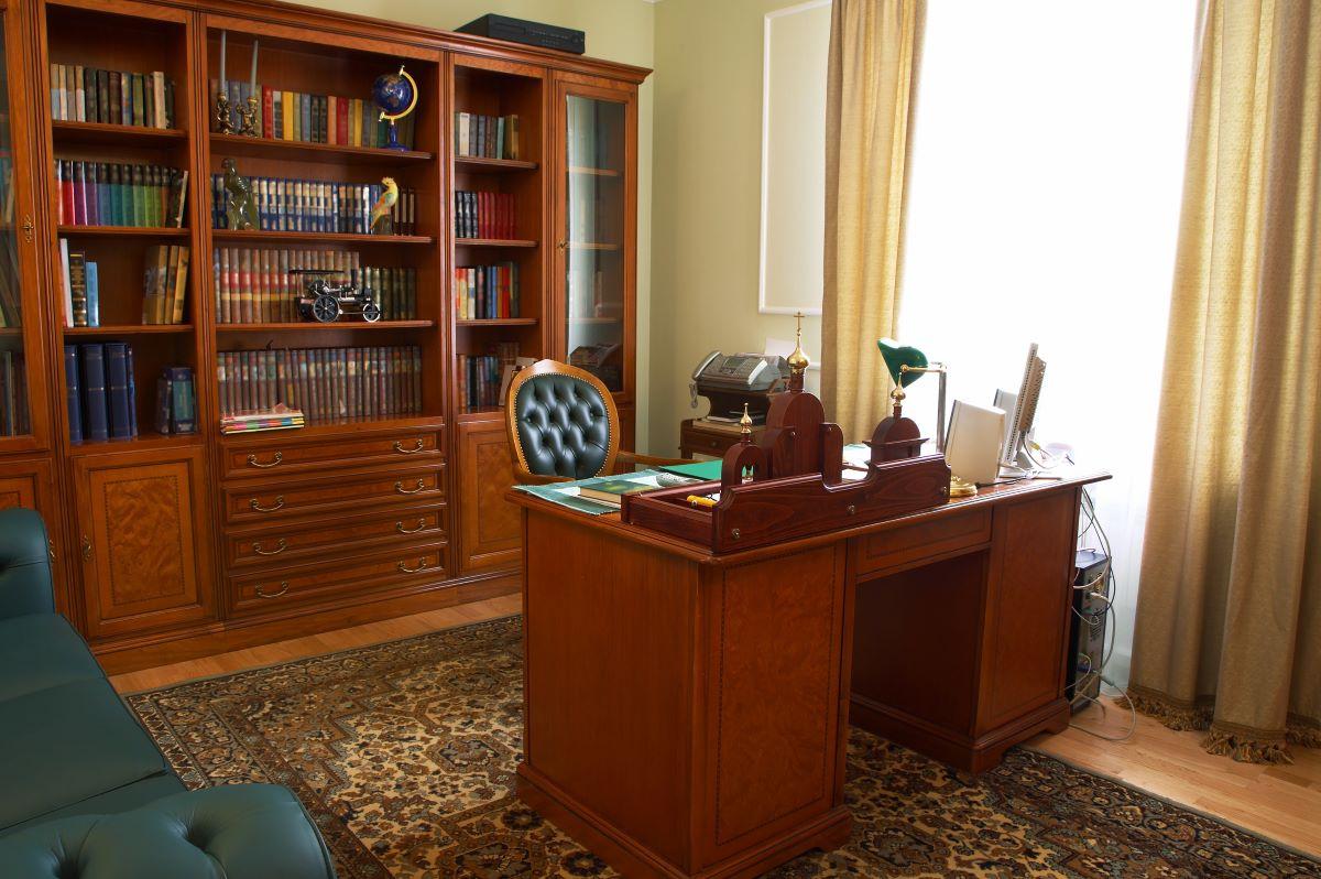 bookshelf behind desk office room