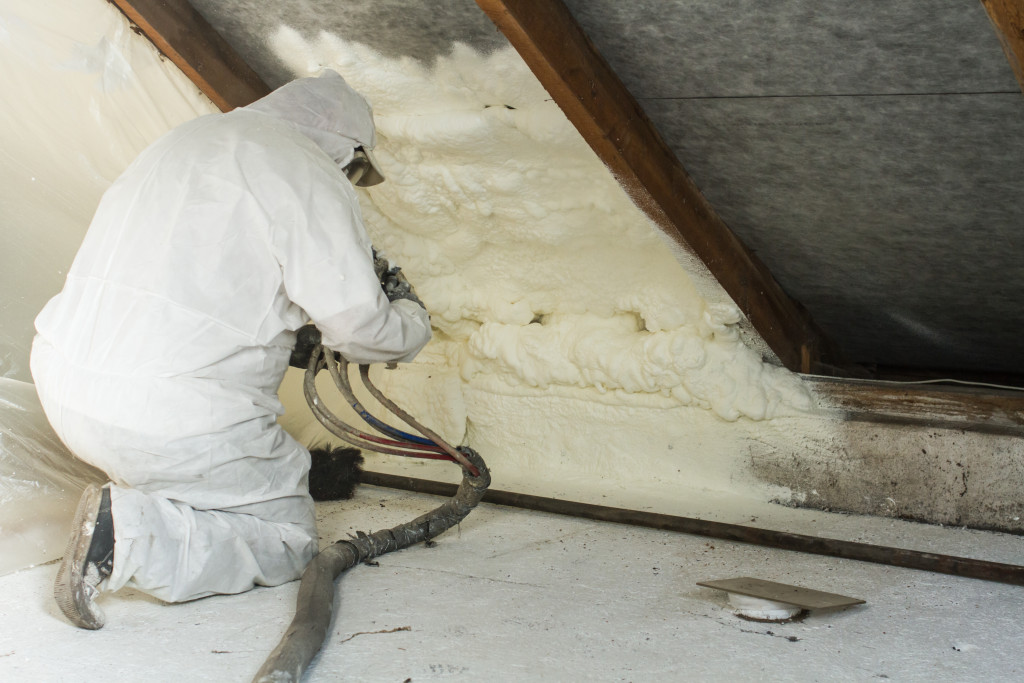 person applying insulating foam