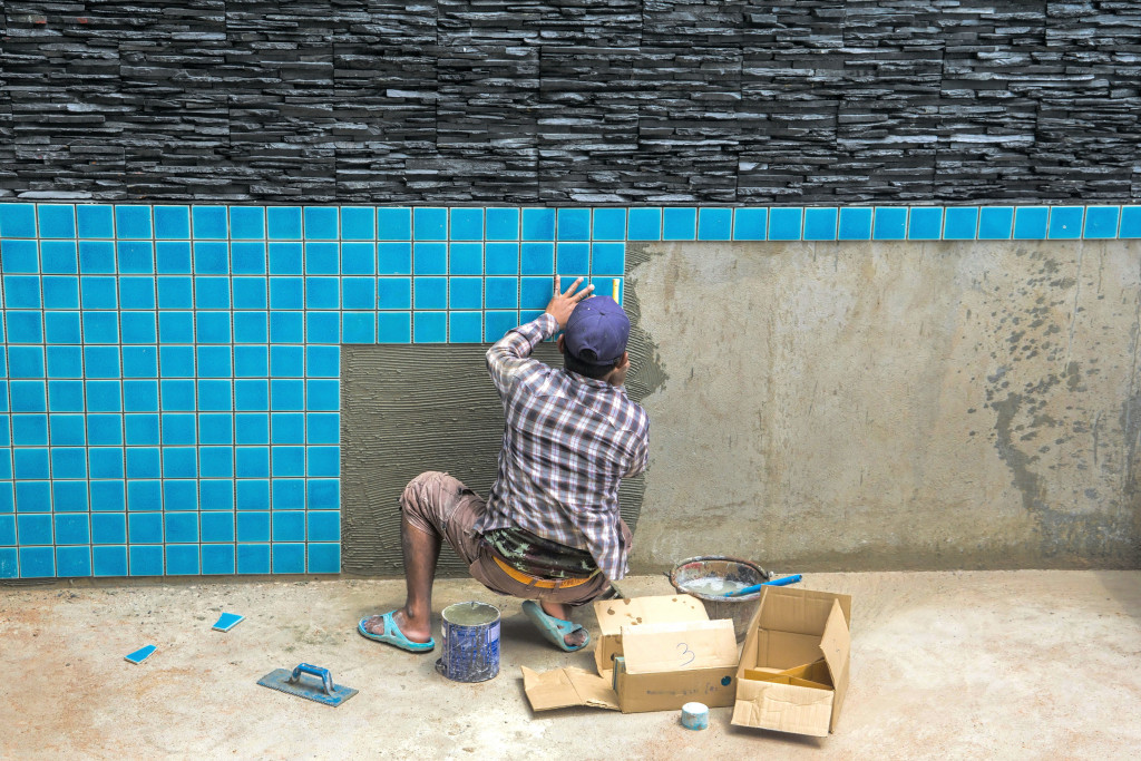 man building a pool