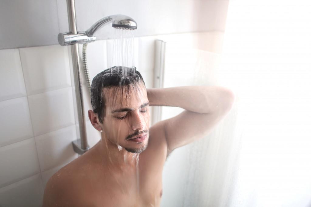 man taking a shower