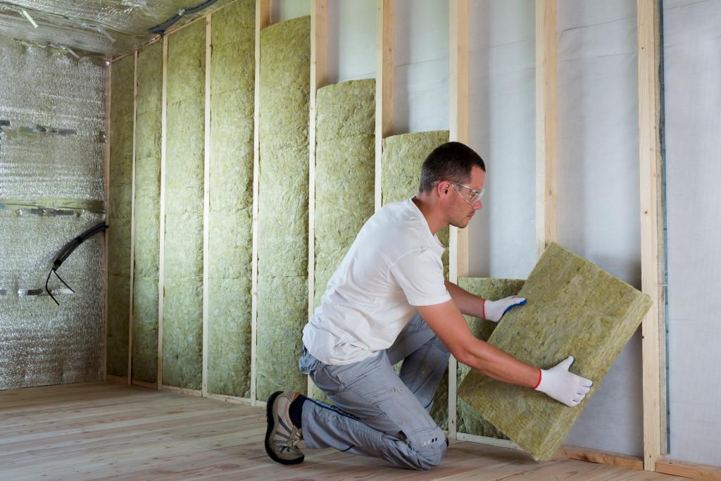 man installing insulation foam