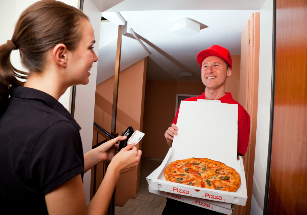 a guy delivering pizza