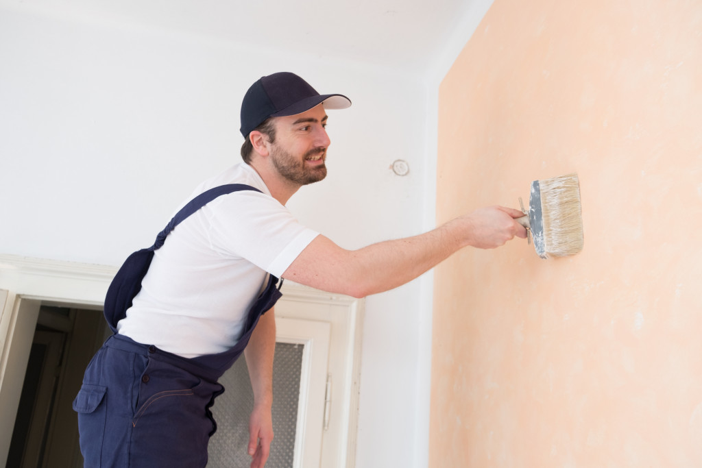 painting a house wall