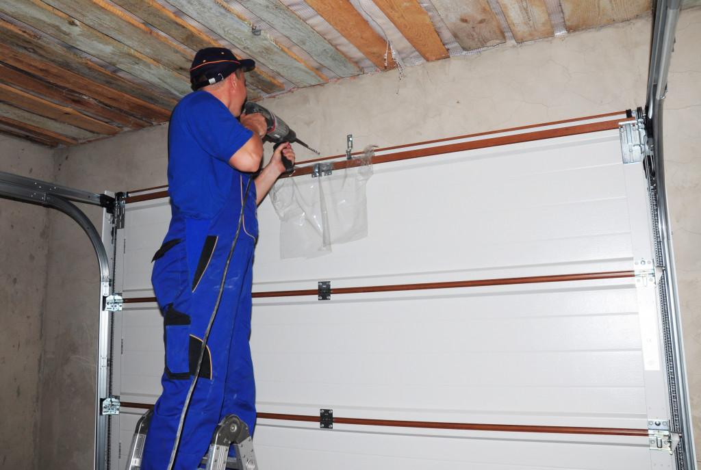 man fixing garage door